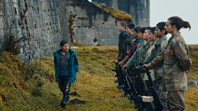 Military parade on a mountain in the film Monos