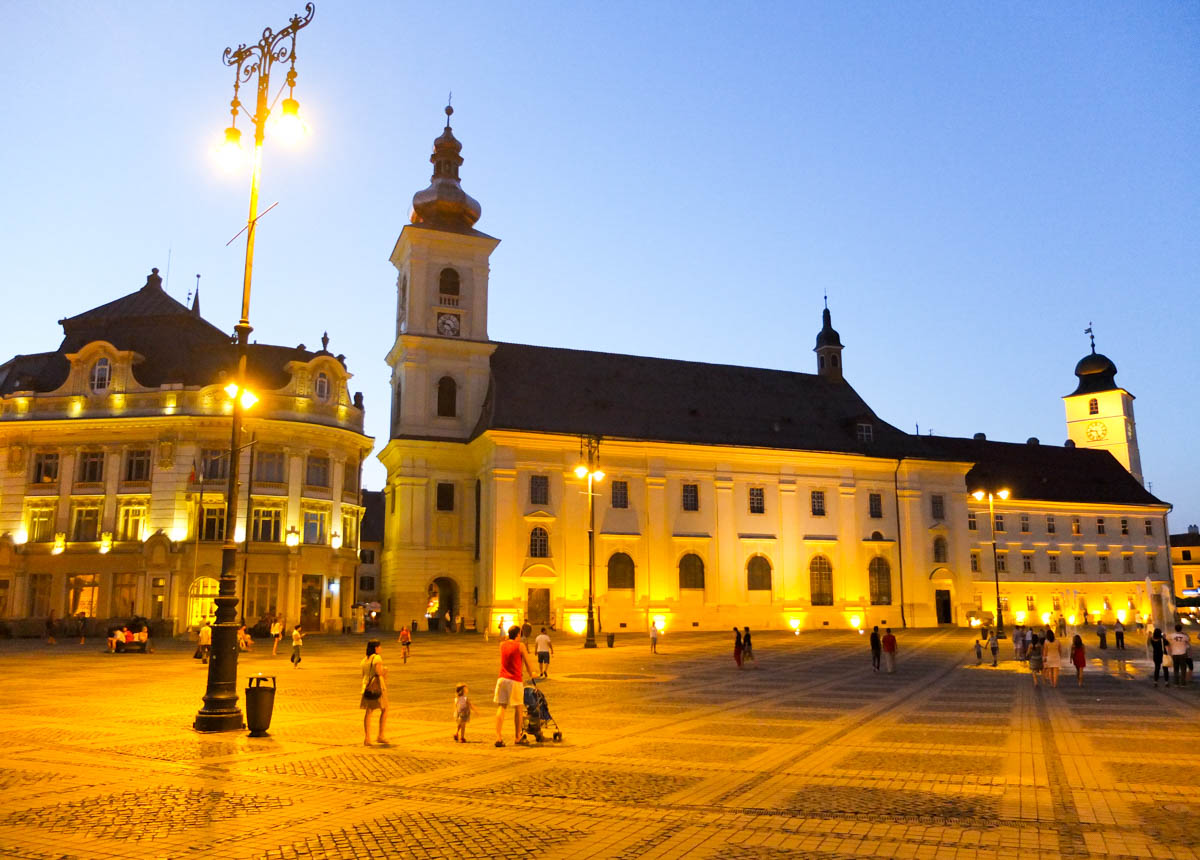 Sibiu in Romania, the main square lit up at night.